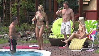 Two tanned blonde Euro babes fucking by the pool Thumbnail