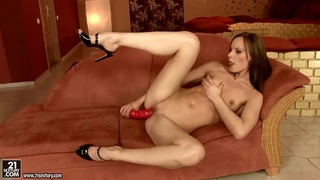 Gitta Blond fucks her pusy with a red sex toy