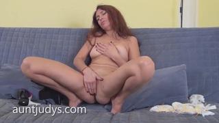 Mature Karolina Masturbates on a Gray Couch Thumbnail