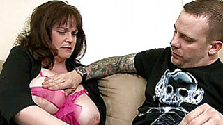 Busty amateur Milf sucks and fucks a young dick Thumbnail