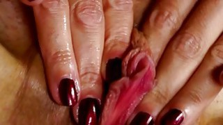 Small titted mature teasing her pussy Thumbnail