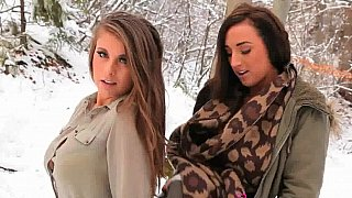 Girls in stockings pose in the snow Thumbnail